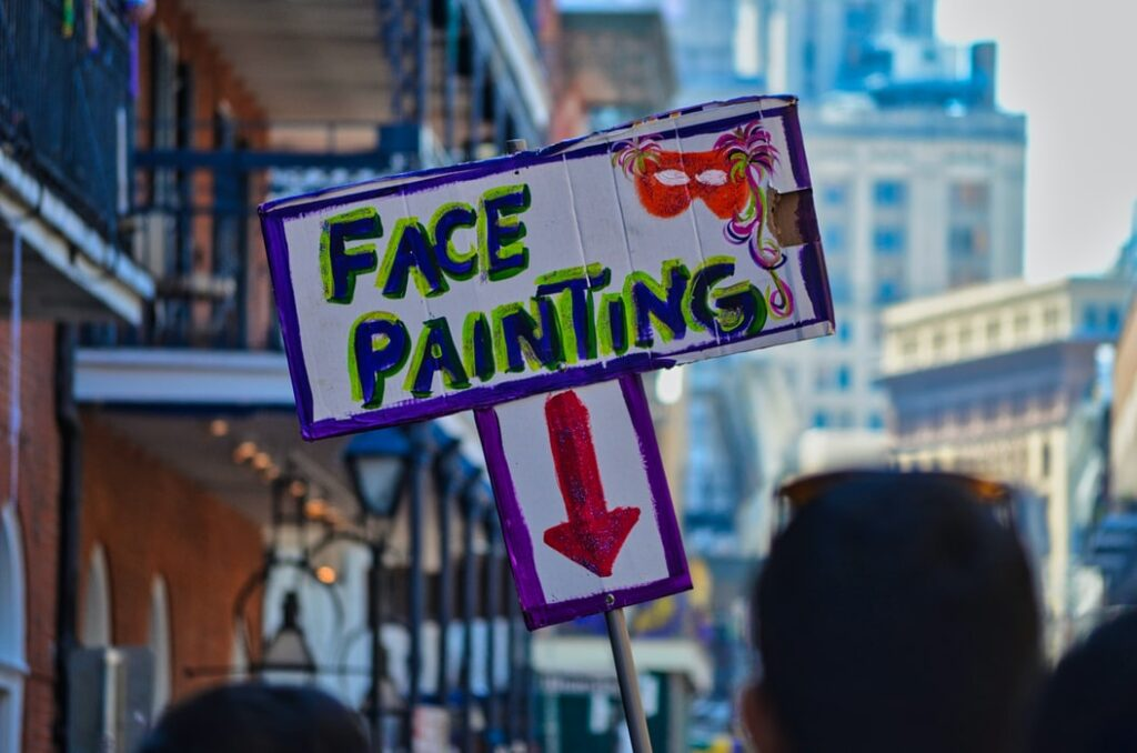 Street sign advertising face painting.