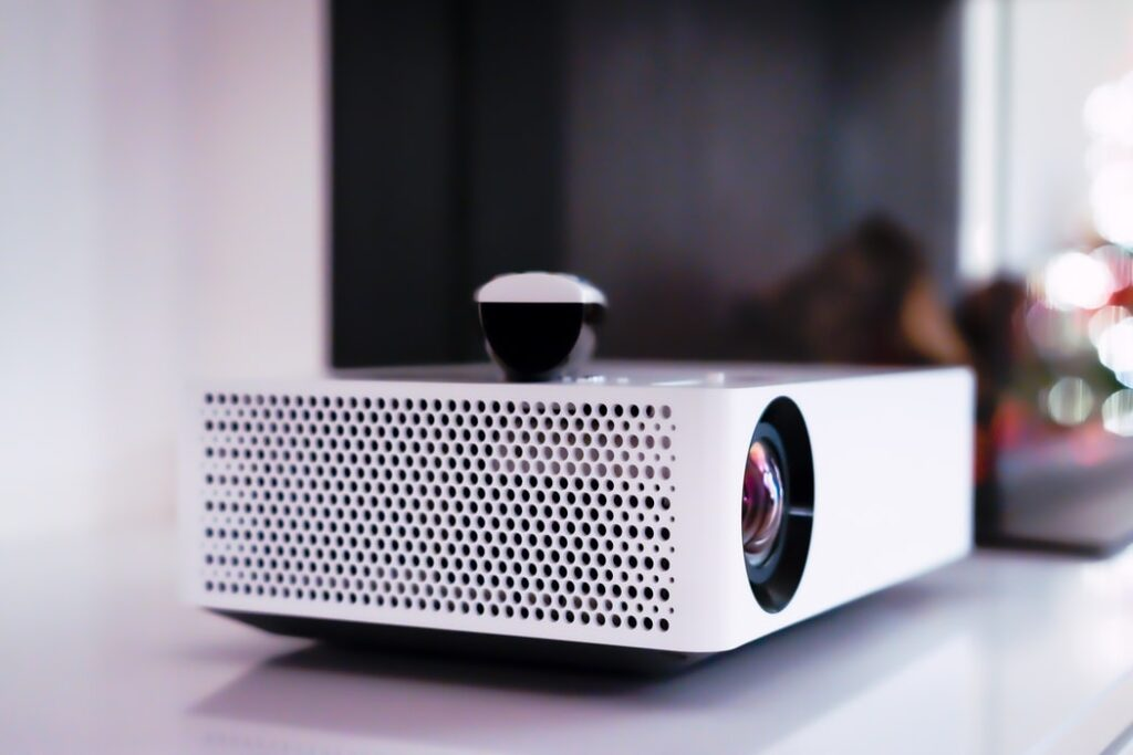 A projector on a desk.
