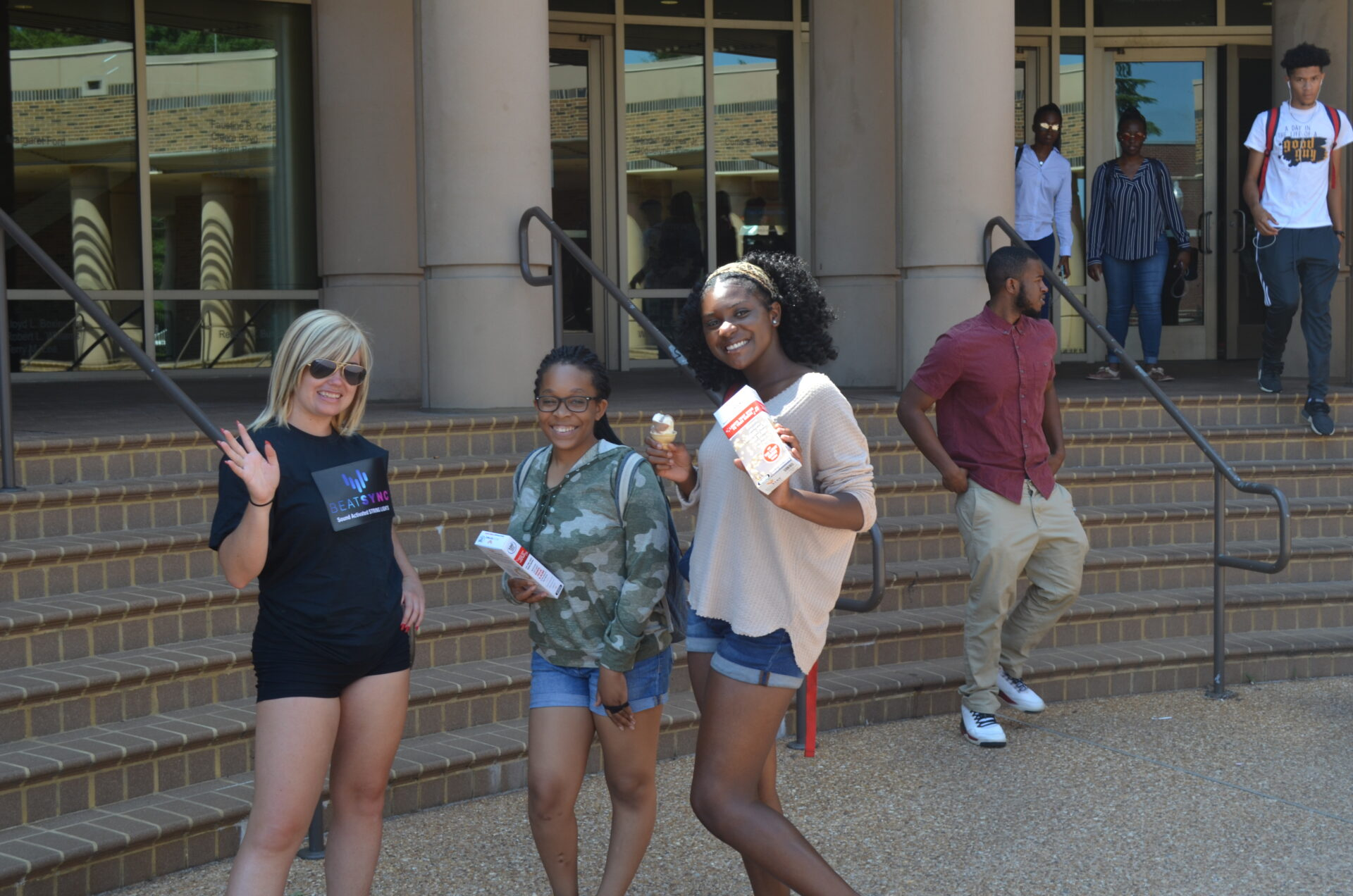 Brand Ambassador at university targeting students giving away free samples. A necessary part of hiring a marketing agency in Miami.